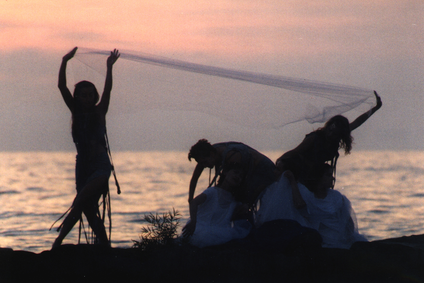 Image of 3 silouettes of MorrisonDancers in front of Lake Erie in their Erie Sirens performance